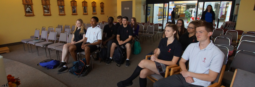 Students sitting in school chapel