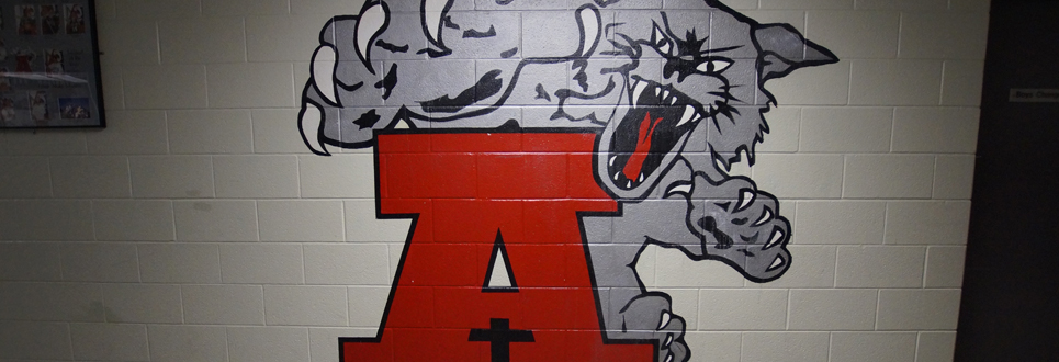school athletic logo painted on wall in hallway